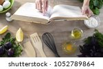 lady reading pizza recipe in... | Shutterstock . vector #1052789864
