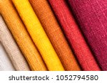 red tone colored linen fabric... | Shutterstock . vector #1052794580