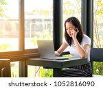 asian woman working with... | Shutterstock . vector #1052816090