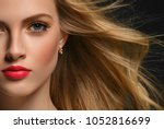 woman with curly long hair... | Shutterstock . vector #1052816699