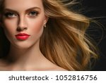woman with curly long hair... | Shutterstock . vector #1052816756