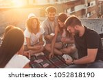 group of young people sitting... | Shutterstock . vector #1052818190