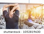 asian fitness man warm up by... | Shutterstock . vector #1052819630