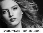 young beautiful woman face... | Shutterstock . vector #1052820806