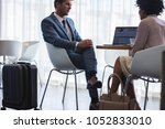 two business colleagues sitting ... | Shutterstock . vector #1052833010
