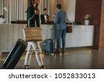 female guest walks inside a... | Shutterstock . vector #1052833013