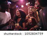 diverse group of young people... | Shutterstock . vector #1052834759