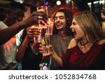 young men and women celebrating ... | Shutterstock . vector #1052834768