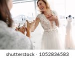 cheerful young woman in wedding ... | Shutterstock . vector #1052836583