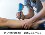 physical therapy of the knee... | Shutterstock . vector #1052837438