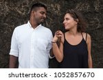 young couple in love holding... | Shutterstock . vector #1052857670