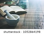 mortar and pestle with... | Shutterstock . vector #1052864198