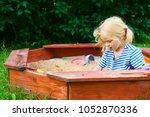 happy little child  adorable... | Shutterstock . vector #1052870336