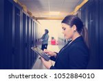 female it engineer working on a ... | Shutterstock . vector #1052884010