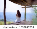young lonely woman sitting in... | Shutterstock . vector #1052897894