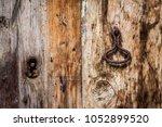 rusty old keyhole detail | Shutterstock . vector #1052899520