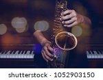 musician plays alto saxophone... | Shutterstock . vector #1052903150