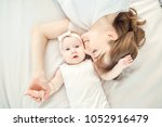 top view of a happy mother... | Shutterstock . vector #1052916479
