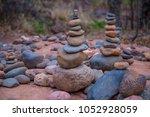 stone cairn rock standing tower ... | Shutterstock . vector #1052928059