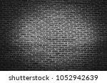 dark brick wall in city downtown | Shutterstock . vector #1052942639