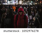 mass of people crossing the... | Shutterstock . vector #1052976278