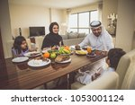arabic happy family lifestyle... | Shutterstock . vector #1053001124