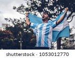 argentinian fan celebrating... | Shutterstock . vector #1053012770