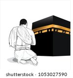 muslim man prying near kaaba... | Shutterstock .eps vector #1053027590