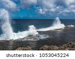 Small photo of Water shoots to the sky from blowholes on the coastline of Alofa as the tide rolls in.