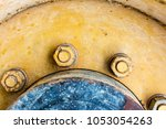 close up tractor yellow aged... | Shutterstock . vector #1053054263