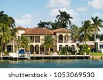 luxury waterfront homes on... | Shutterstock . vector #1053069530