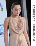 LOS ANGELES, CA - DECEMBER 9, 2011: Miley Cyrus at the American Giving Awards at the Dorothy Chandler Pavilion in Los Angeles. December 9, 2011  Los Angeles, CA - stock photo