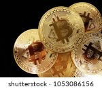 golden bitcoins. cryptocurrency ... | Shutterstock . vector #1053086156
