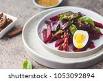 salad from boiled beet  young... | Shutterstock . vector #1053092894