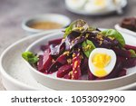 salad from boiled beet  young... | Shutterstock . vector #1053092900