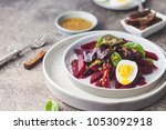 salad from boiled beet  young... | Shutterstock . vector #1053092918