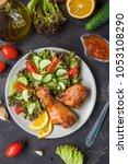 fried chicken legs and fresh... | Shutterstock . vector #1053108290