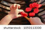 Small photo of baby hands cutting plasticine - fine motor skill develop dexterity