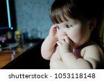 baby girl in lamp light at... | Shutterstock . vector #1053118148
