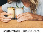 mango and chia pudding served... | Shutterstock . vector #1053118976