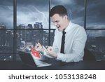 angry caucasian businessman... | Shutterstock . vector #1053138248