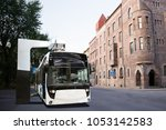 electric bus at a stop is... | Shutterstock . vector #1053142583