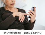 a positive modern elderly woman ... | Shutterstock . vector #1053153440