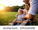 happy family in a park in... | Shutterstock . vector #1053166208