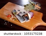 herring fillet  on a cutting... | Shutterstock . vector #1053175238