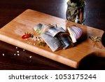 herring fillet  on a cutting... | Shutterstock . vector #1053175244