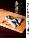 herring fillet  on a cutting... | Shutterstock . vector #1053175268