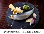 herring entirely with ginger... | Shutterstock . vector #1053175280