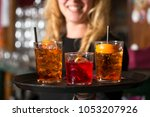 three cocktails on a tray  two... | Shutterstock . vector #1053207926