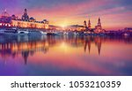 fantastic colorful sunset over... | Shutterstock . vector #1053210359